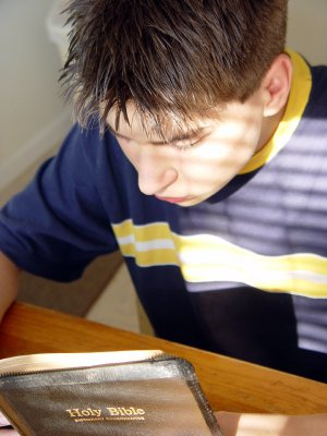 young man reading Bible